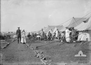 Medical and nursing sisters of 3rd Australian General Hospital (3AGH) in the tent lines with patients J01438